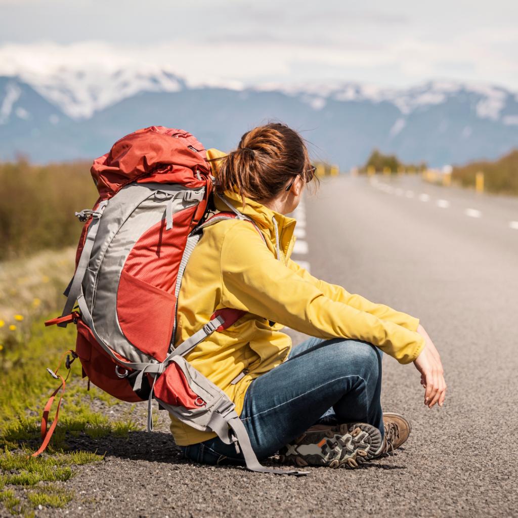 budget travel women backpack hitch-hiking