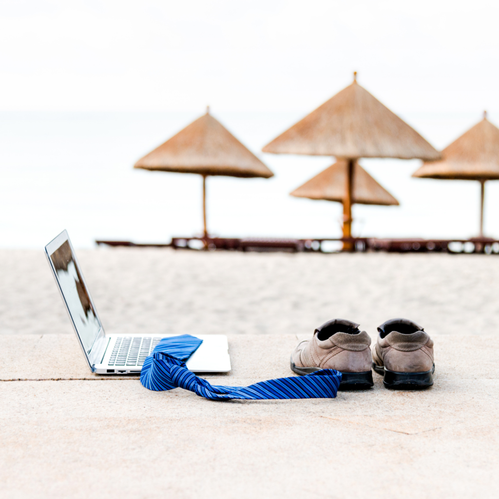 Business Travels laptop Work on the beach with nipa hut