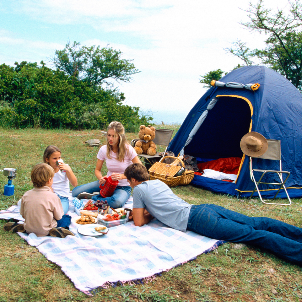 family camping in a blue tent