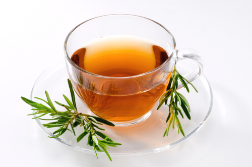 Rosemary Tea with ht water in a clear tea cup