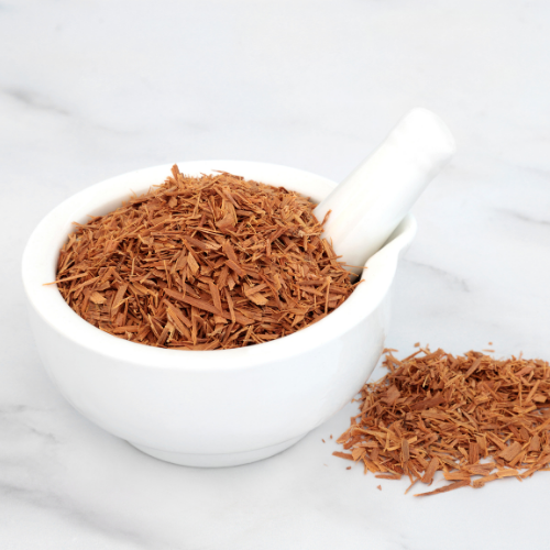 Cats Claw Herb in a bowl and table