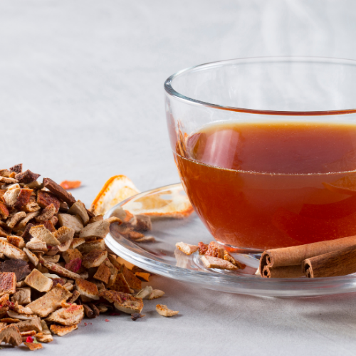 Cats Claw Herb Tea in a glass cup
