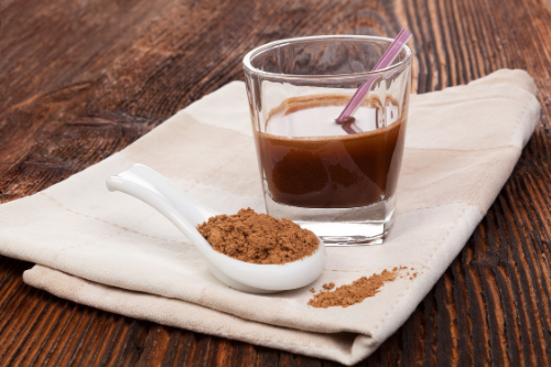 Reishi with Cacao Coffee Alternative in a Glass and spoon